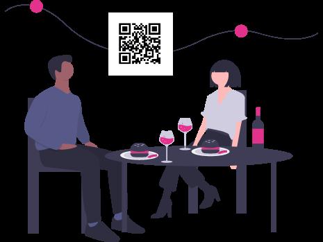 Due persone sedute ad un tavolo